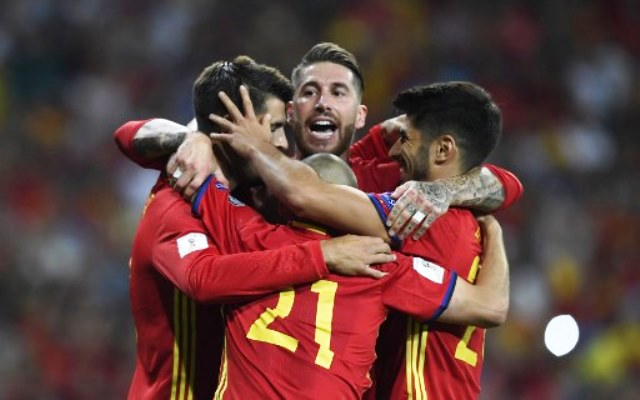 Spain's forward Alvaro Morata (L) celebrates with Spain's defender Sergio Ramos (C) and teammates after scoring their third goal during the World Cup 2018 qualifier football match Spain vs Italy at the Santiago Bernabeu stadium in Madrid on September 2, 2017. / AFP PHOTO / GABRIEL BOUYS