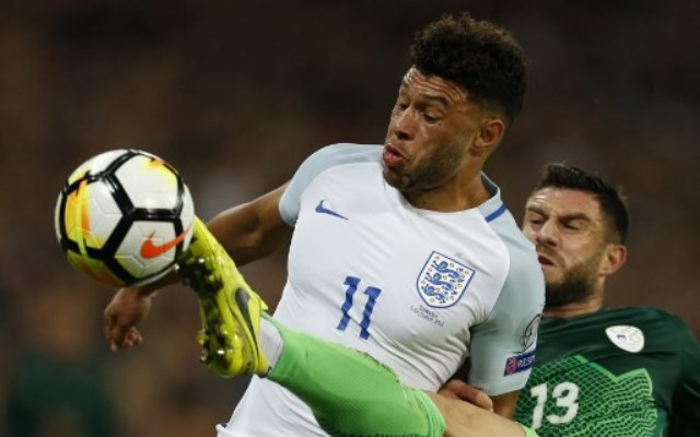 Slovenia's defender Bojan Jokic (R) challenges England's midfielder Alex Oxlade-Chamberlain (L) during the FIFA World Cup 2018 qualification football match between England and Slovenia at Wembley Stadium in London on October 5, 2017.  / AFP PHOTO / Ian KINGTON / NOT FOR MARKETING OR ADVERTISING USE / RESTRICTED TO EDITORIAL USE